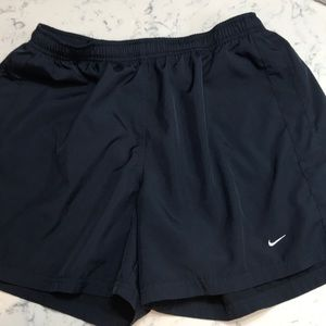 Navy unlined 100% polyester Nike shorts